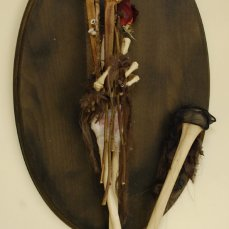 human arm, articulated and mounted with roses and sea urchin spines